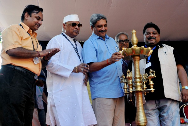 The Chief Minister of Goa, Shri Manohar Parrikar lighting the lamp to inaugurate the silver jubilee celebrations of the Open Forum at the  44th India International Film Festival of India (IFFI-2013), in Panaji, Goa on November 23, 2013.  The Vice Chairman of Entertainment Society of Goa, Vishnu Wagh, Film Maker Shri Sanskar Desai and the Chairman of the Federation of Film Societies of India (FFSI), Kiran Shantaram are also seen.